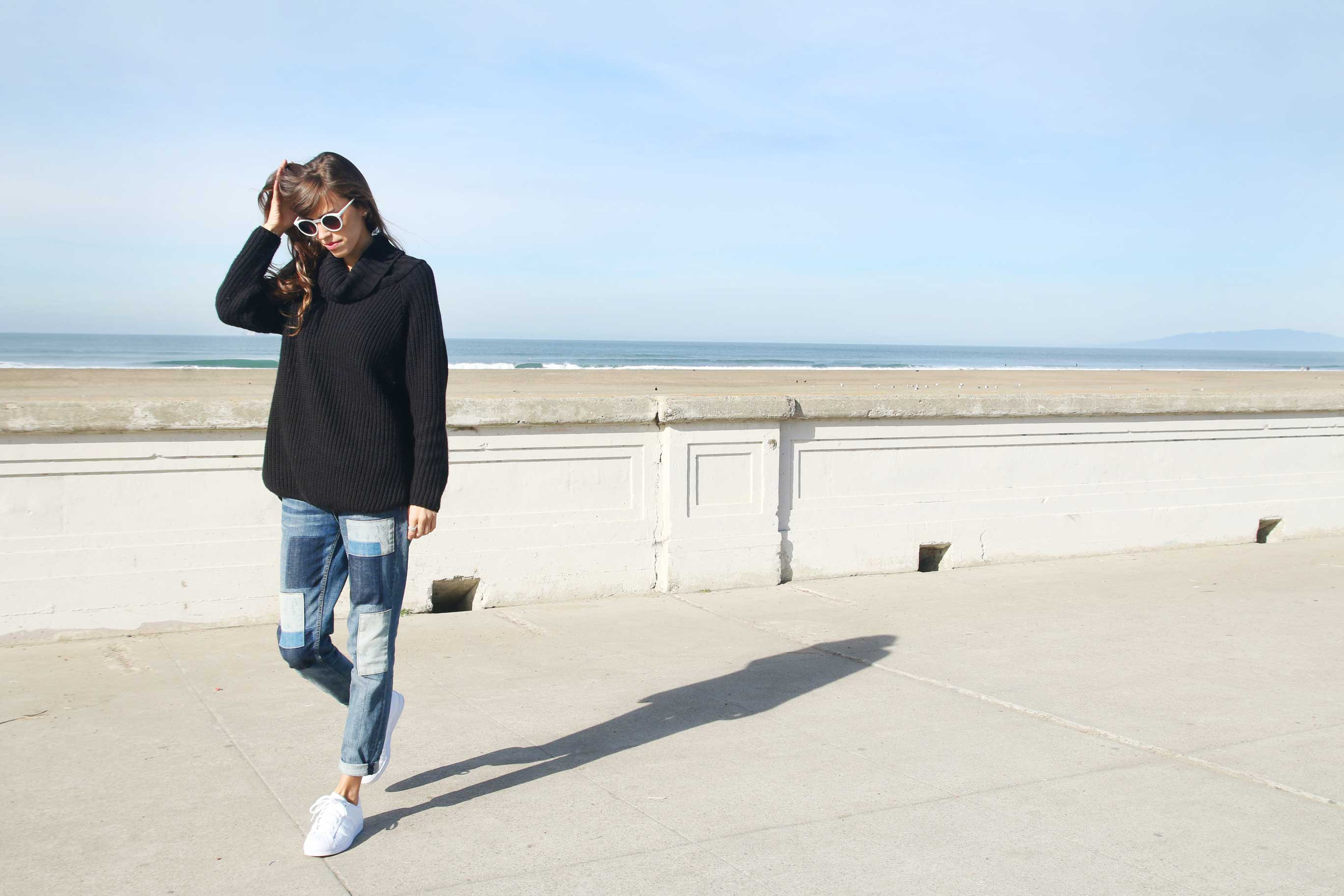kendall at beach in turtleneck, jeans and adidas